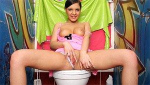 Sultry Brunette Teen Stuffs Wet Pussy