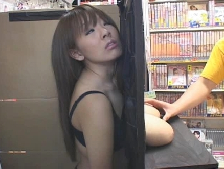Hitomi puts her Big Tits on Display at the Store